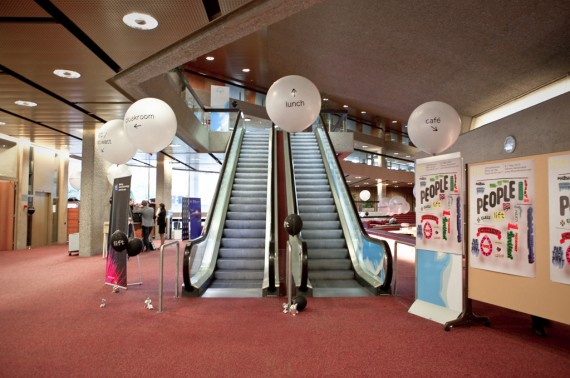 Wayfinding system with oversized balloons.