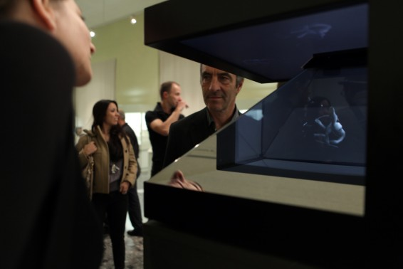 Visitors interacting with the hologram.